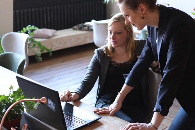 Two Women Using Laptop